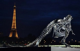 """Soaring over the seine river in Paris sits a life-size Tyrannosaurus-Rex sculpture, conceived and constructed by french artist Philippe Pasqua."" Full-Scale T-Rex near Seine Paris by Philippe Pasqua Full-Scale T-Rex near Seine Paris by Philippe Pasqua Paris Design Agenda Full Scale T Rex in Paris by Philippe Pasqua 05 e1373446214195 324x208"