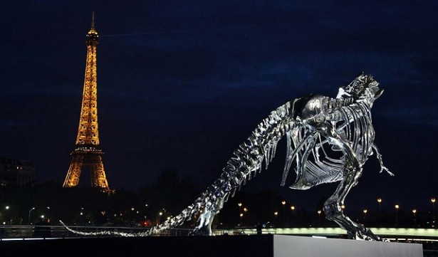 """Soaring over the seine river in Paris sits a life-size Tyrannosaurus-Rex sculpture, conceived and constructed by french artist Philippe Pasqua."" Full-Scale T-Rex near Seine Paris by Philippe Pasqua Full-Scale T-Rex near Seine Paris by Philippe Pasqua Paris Design Agenda Full Scale T Rex in Paris by Philippe Pasqua 05 e1373446214195"